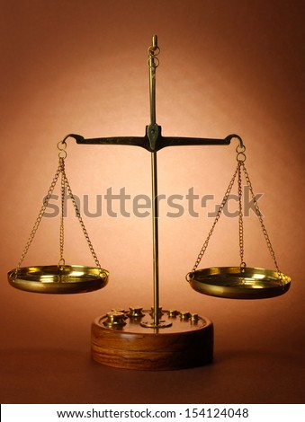 Classic scales on brown background - stock photo