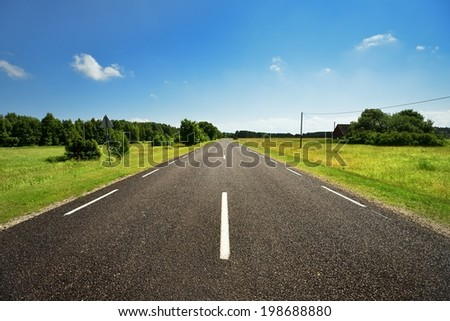 classic scene of a highway in rural area - stock photo