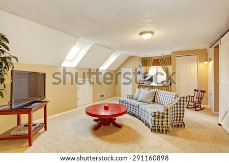 Classic secondary living room with carpet, tv, and sofa. - stock photo