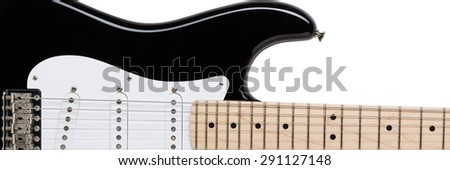 Classic shape black and white electric guitar with wooden maple neck isolated on white with clipping path. Musical instruments shop or school concept. Letterbox view - stock photo