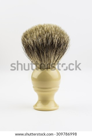 Classic shaving brush using badger hair bristles.