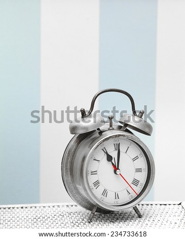 classic silver clock  watch in bright colorful retro interior  - stock photo