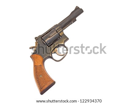 Classic six shooter. Profile of a .38 caliber gun with wood grip. Isolated on a white background. Room for text.