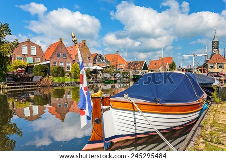 Classic sloop in the Frisian village of Hindeloopen, The Netherlands - stock photo