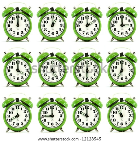 classic small alarm clock twelve hours isolated on white background multiple image - stock photo