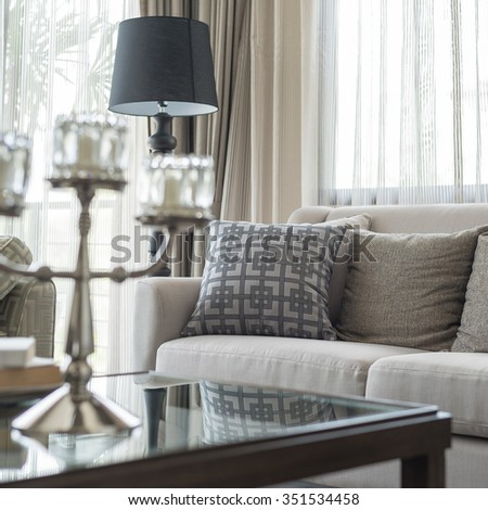classic sofa with pillows in living room, blur foreground effect - stock photo