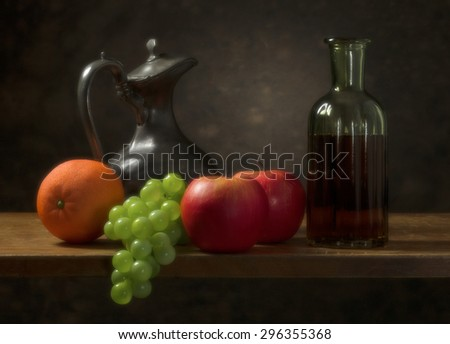 Classic still life with fruit and jug with glass bottle. - stock photo
