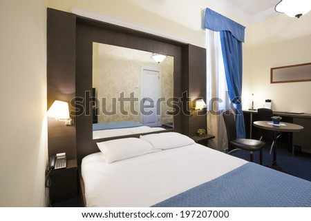 Classic style hotel bedroom interior