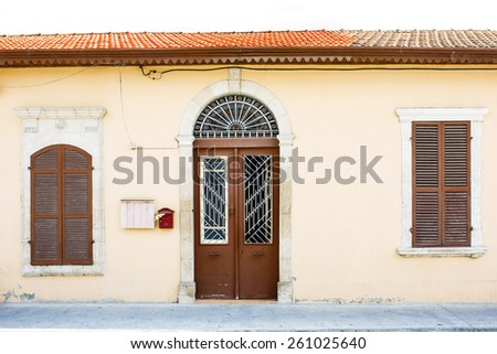 Classic style Mediterranean Europe house entrance, closed window shutters and door. - stock photo