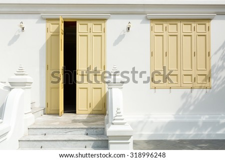 Classic style of a retro staircase ,yellow doors and windows.