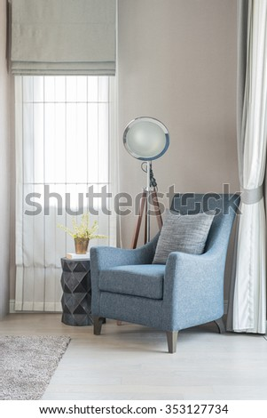 classic style sofa with pillows and modern lamp in living room - stock photo