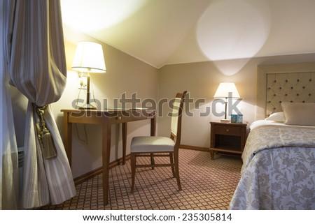 Classic styled hotel bedroom interior - stock photo