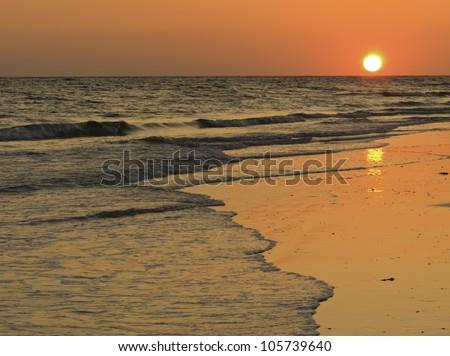 Classic sunset over Gulf of Mexico near Sarasota, Florida - stock photo