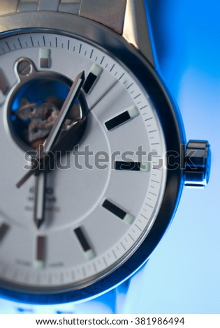 Classic Swiss Watch with Aqua Glow - stock photo