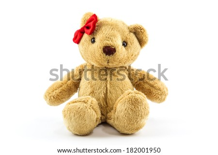 Classic teddy bear red bow on head isolated white background. - stock photo