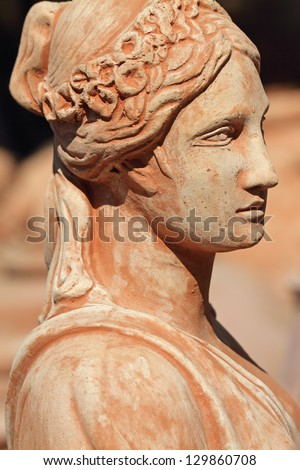 classic terracotta sculpture with female  profile, Tuscany , Italy, Europe - stock photo