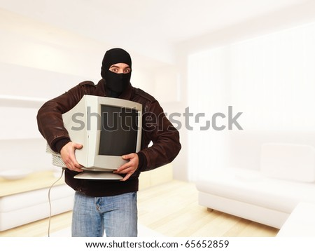 classic thief in action in house - stock photo