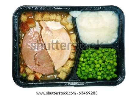 "Classic Turkey and Stuffing ""TV Dinner"" in its black plastic tray, isolated on white with room for your text - stock photo"