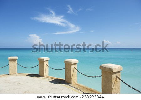 Classic turquoise Caribbean Sea view from a platform at a resort in Varadero, Cuba - stock photo