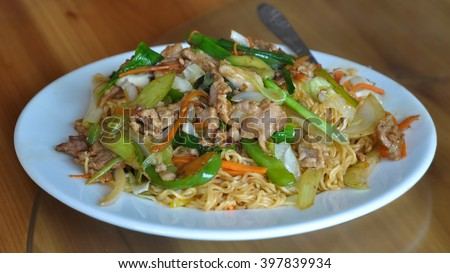 Classic vietnamese food - noodles with meat and vegetables. - stock photo