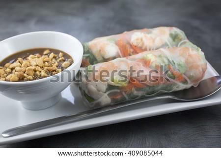 Classic Vietnamese spring roll. Shrimp, pork, cilantro, mint and peanut sauce - stock photo