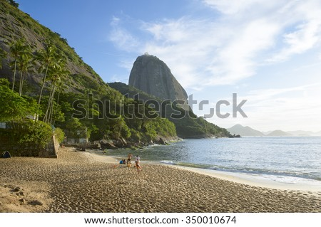 Classic view of Sugarloaf Mountain Pao de Acucar from Praia Vermelha Red Beach at Urca on a quiet morning in Rio de Janeiro, Brazil  - stock photo