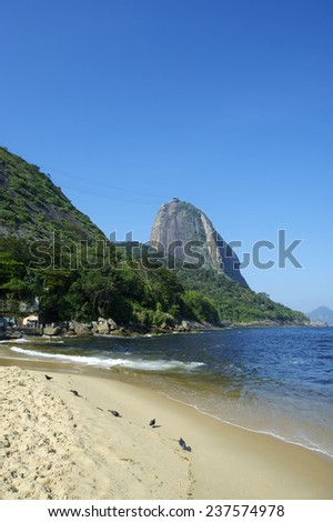 Classic view of Sugarloaf Mountain Pao de Acucar Rio de Janeiro Brazil from Praia Vermelha Red Beach at Urca - stock photo
