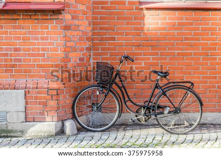 Classic Vintage Bicycle standing near house on street in Malmo, Sweden - stock photo