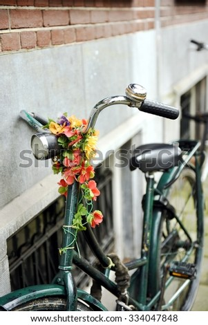 Classic vintage bike with flower parked in Amsterdam - stock photo