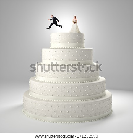 classic wedding cake with groom and bride - stock photo