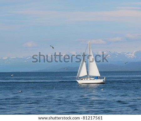 Classic white sailboat in the bay on a sunny summer day in Alaska - stock photo
