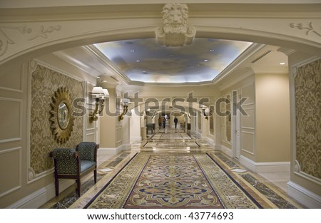 Classic wide corridor with settee carpet and decorated mirror - stock photo
