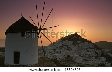 Classic windmill over looking Ios town in Greece