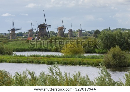 Classic windmills in Kinderdijk, Holland - stock photo