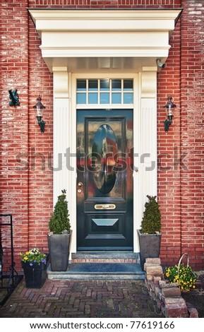 Classic wooden door in Amsterdam, Netherlands - stock photo