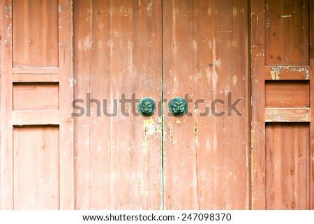 Classic wooden door with iron handle - stock photo