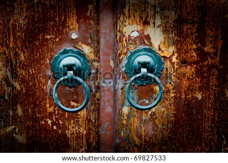 Classic wooden door with iron handle. - stock photo
