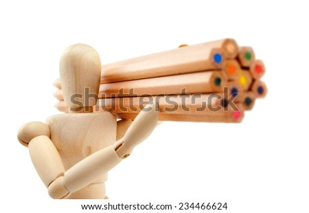 Classic wooden dummy holds a bunch of colorful pencils like a huge lumber, isolated on white. - stock photo