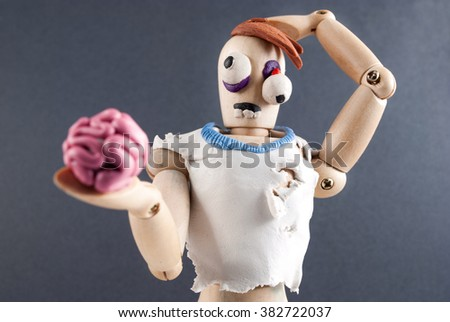 Classic wooden dummy infected by plasticine becomes zombie.
