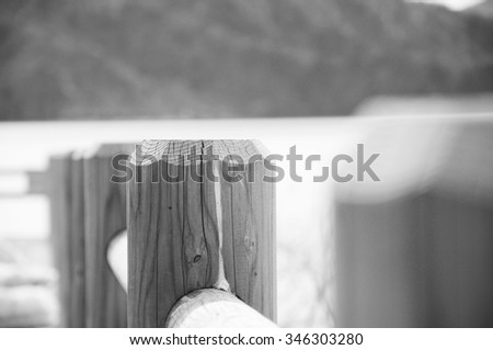 Classic wooden fence - focus on the middle log - black and white effect