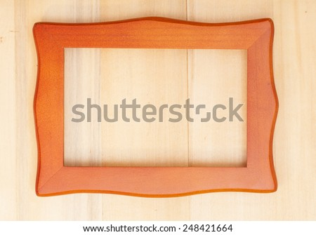 Classic wooden frame on wood background  - stock photo