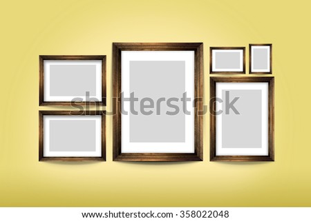 Classic wooden Picture frame design  on yellow wall