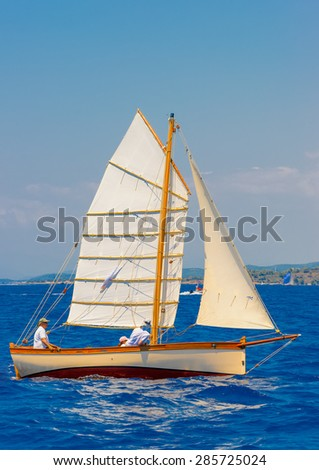 classic wooden sailing boats in a race, Spetses island in Greece