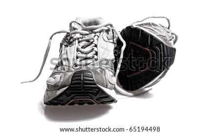 Classic worn sports running or gym sneaker trainer shoe foot ware - stock photo