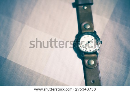 classic Wristwatch on brown tone color background vintage style - stock photo