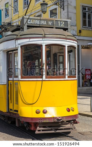 Classic yellow tram of Lisbon, Portugal - stock photo