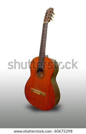 Classical acoustic guitar on grey background