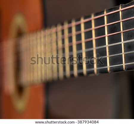 Classical acoustic guitars . Close-up view.