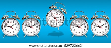 Classical alarm clock on blue background. Team
