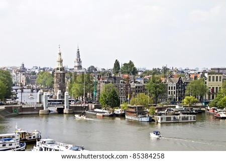 Classical Amsterdam view at the harbor from Amsterdam in the Netherlands - stock photo
